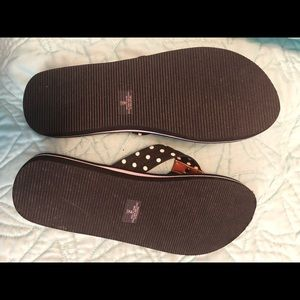 Tommy flip flops.  Never worn